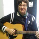 Devon playing guitar at Red Guitar