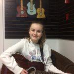 having fun taking lessons at Red Guitar