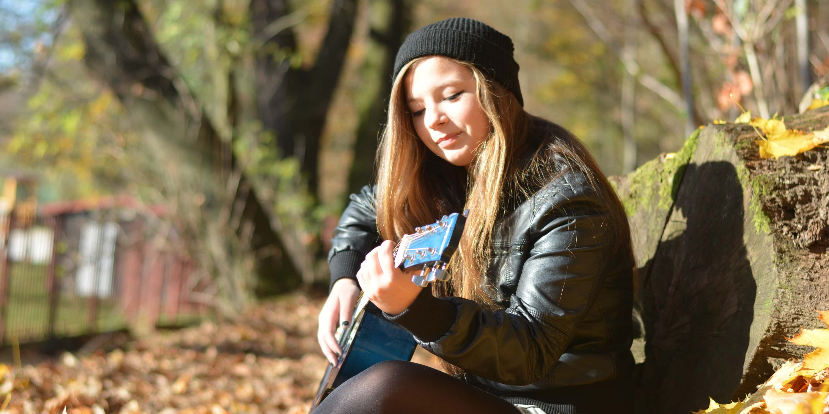 playing the guitar in the fall